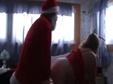Santa Claus Has Quicky With His Fat Santa Helper