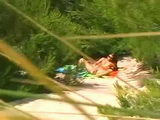 Voyeur Secretly Taped Chick At Nudist Beach Masturbating