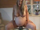 Pregnant Chick Riding A Huge Dildo